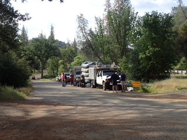 Staging area at launch site. There are a number of different rafting businesses that take turns launching.