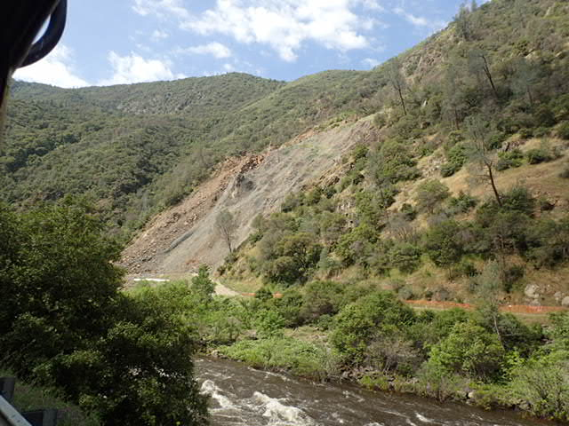 A recent earthquake damaged the hillside netting used to stabilize the hillside.