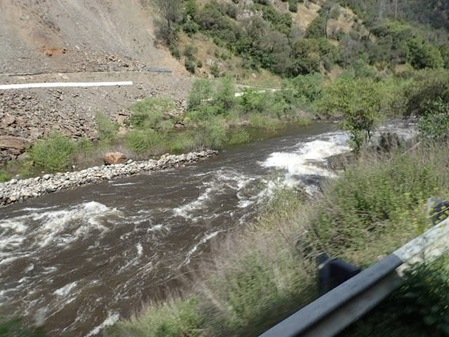 Merced River on left driving towards Yosemite National Park.